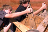 (AURORA, Colo., October 8, 2004)Jared Rosendale, 12, and Landon Rosendale, 14, work together to...