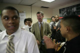 Mayor John Hickenlooper (cq) talks with students after teaching a world literature class at...
