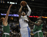 Carmelo Anthony splits brian Scalabrine and Brian perkins in the 1st half as the Nuggets host the...