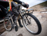 (Rollinsville, Colorado, Feb. 22, 2009) Shenk rides a specially-designed mountain bike that can...