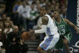 J.R. Smith (cq) of the Nuggets is picked by Gabe Pruitt (cq) of the Celtics during the second...