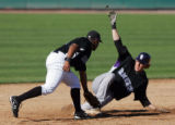 (0603) Chris Frey slides into second ahead of the tag by Chris Nelson at the Colorado Rockies...