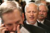 Rep. Mike Coffman, R-CO., center, waits in line before an interview with the media in Statuary...