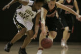 #13 Adaugo Osuala (cq) of Green Mountain reaches for the ball against #32 Sierra Bender (cq) of...