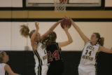 #12 Erin Andersen (cq) and #34 Danielle Stephan (cq) of Green Mountain block the shot of #24 Sarah...