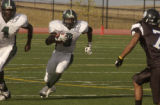(AURORA, Colo., September24, 2004) Smoky Hill's #9, Rickey Ruff, brings the ball upfield against...