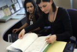 Denver Department of Human Services On-going Child Protection Caseworker Molly Byrum, r, works...