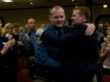 Trooper Randy Orton is hugged by Dr Jason Rhodes before receiving his 'Life Saving Award' for...
