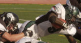 (AURORA, Colo., September24, 2004) Smoky Hill's #9 RIckey Ruff sniggles a few extra yards in this...