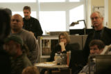 Employees of the Rocky Mountain News listen to Scripps executives discuss the decision to close...
