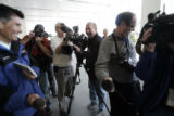 The media gathers to photograph staffers in the lobby ot the Rocky Mountain News  of the Rocky...