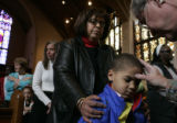 Camden Long, 5, celebrates Ash Wednesday with his grandmother, Linda Long, at St. Ignacius Loyola...