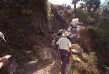 UP THE MOUNTAIN: Villagers carrying Osveli's casket pick their way along a narrow trail. More...