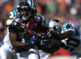 (Denver., on Sun. Oct. 10, 2004)   Denver Broncos runningback Reuben Droughns, #34, tries to shake...
