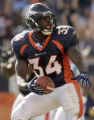 (DENVER., CO., OCTOBER 10, 2004) Denver Broncos' #34, Reuben Droughns looks up to celebrate his...