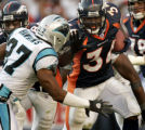 (DENVER., CO., OCTOBER 10, 2004) Denver Broncos' #34, Reuben Droughns, right, follows the block of...