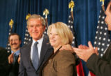 President George W. Bush is greeted by Marilyn Musgrave at the Brown Palace Hotel, during a...