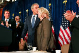 President George W. Bush kisses Congresswoman Marilyn Musgrave after speaking at the Brown Palace...