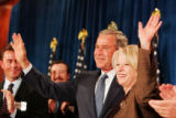 President George W. Bush and Marilyn Musgrave wave to the crowd at the Brown Palace Hotel, during...