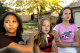 (AURORA, Colo., Nov. 3, 2005) Friend and neighbor Venissa Bishop,(cq) 12, comforts Kelsey...