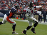 Atlanta Falcons' #7, Michael Vick, right, runs for a 5-yard gain during first quarter action held...