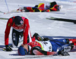 Milan Sperl, of the Czech Republic, left, crouches on the ground next to Martin Bajcicak, of...