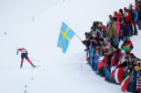Kikkan Randall, of the USA, climbs a hill in the women's cross-country sprint qualifier at the...