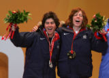 Olympic silver medalist Danny Kass, left, and gold medalist Shaun White cheer after receiving...
