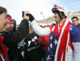 Seth Wescott is congratulated by friends and fans after winning the gold medal in the men's...