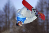 Andy Finch goes upside-down during snowboard practice at Bardonecchia in preparation for the Mens...
