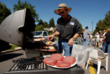 (DENVER Colo. September 29,2004)  Avery Grimes cooks some hamburgers and other food at a block...