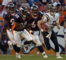 (Denver, Colo., on Sunday, Sept. 26, 2004) Denver Broncos Mario Fatafehi, #68, Reggie Hayward, #...