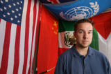 Geography teacher Eric Hamlin in his home with flags from his classroom. Hamlin was suspended with...