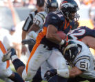 (DENVER, COLO., SEPTEMBER 26, 2004) - Denver Broncos' #22, Quentin Griffin, left, manages a 1-yard...