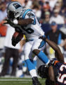 (DENVER., CO., OCTOBER 10, 2004) Denver Broncos defenders, #56, Al Wilson, #31, Kelly Herndon and...