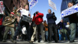 Demonstrators voiced their opposition to Bush administration policies outside the Brown Palace...