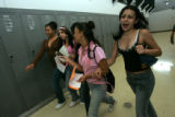 After an orientation assembly at Montbello, HS freshmen Perla Ruiz, Brenda Aragon, Selene Mendez,...