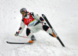U.S. Moguls skiier Jeremy Bloom has some trouble sticking a landing during practice before his...
