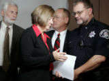 A worn out Boulder District Attorney Mary Lacy leaves after a press conference to a select group...