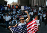 Demonstrators marched around Denver's Civic Cente Park during a National Day of Action rally to...