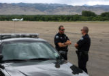Boulder Police officers Owen McKinney left, and Brandon Murray right, block the Jefferson County...