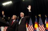 (10/08/2004) Denver-President George W. Bush and Senate candidate Pete Coors wave to supporters at...