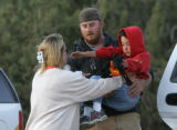 Zak Slutzky, from the Western State College Rescue team hands Evan Thompson over to his aunt Teddy...