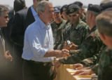 President George Bush greets a crowd of military personal gathered on the air strip at Buckley AFB...