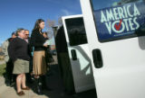 John Parker and Jessica Johnson prepare to board a van that will transport them from Denver...