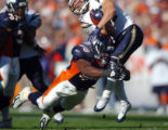 (DENVER, Co., SHOT 9/26/2004) The Denver Broncos' Terry Pierce (#58, LB) tackles  the San Diego...