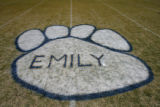 Emily Keyes' name appears inside the giant Huskie paw at the 50-yard-line of the Platte Canyon...