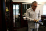 At his Niwot, Colorado office, Crocs CEO Ron Snyder reviews a pair of  Crocs sandals licensed for...