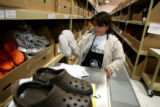 Margarita Quinonez fulfills internet orders for Crocs products at the manufacturers Niwot campus...