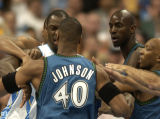 (Denver,CO,Shot On 4/27/04-- Nuggets Francisco Elson(left) gets into a pushing match with...